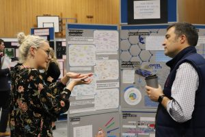 Sixth Form girl explaining her work on engineering to a teacher